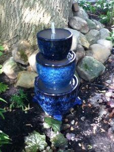 blue planter fountain