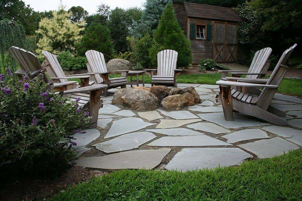 9 Ideas That'll Convince You To Add A Firepit To Your Backyard