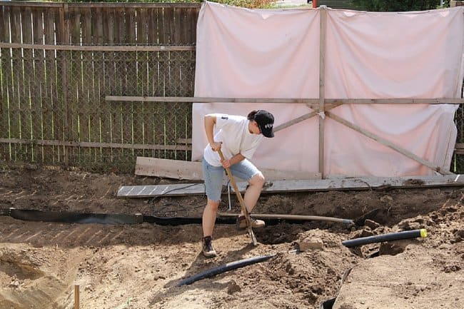 man-digs-in-backyard