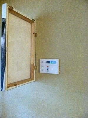hide thermostat behind painting