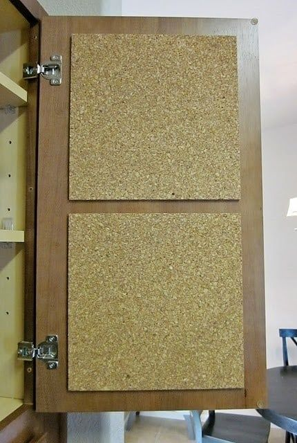 cork board inside cupboard