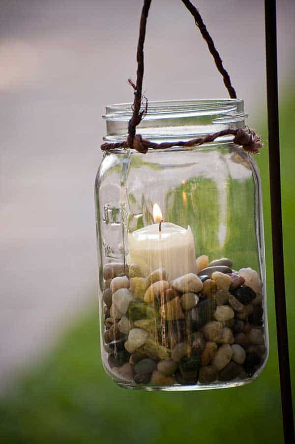 mason jar with candle and pebbles