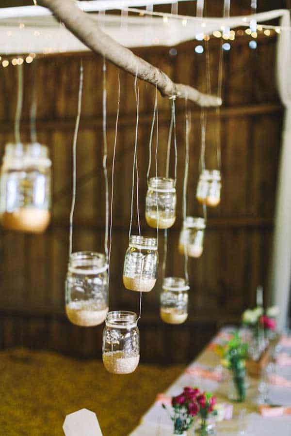 mason jars hanging from a branch