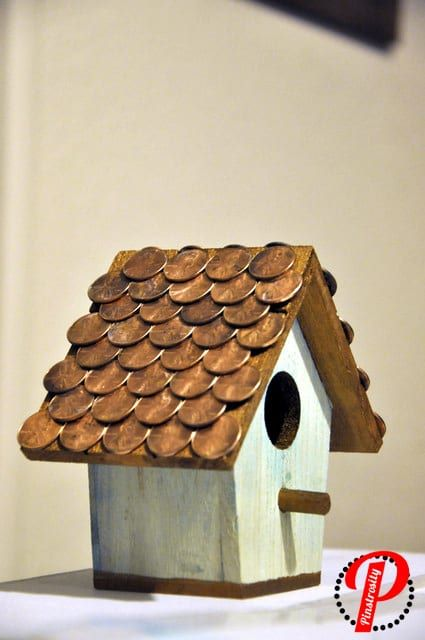 penny covered bird house