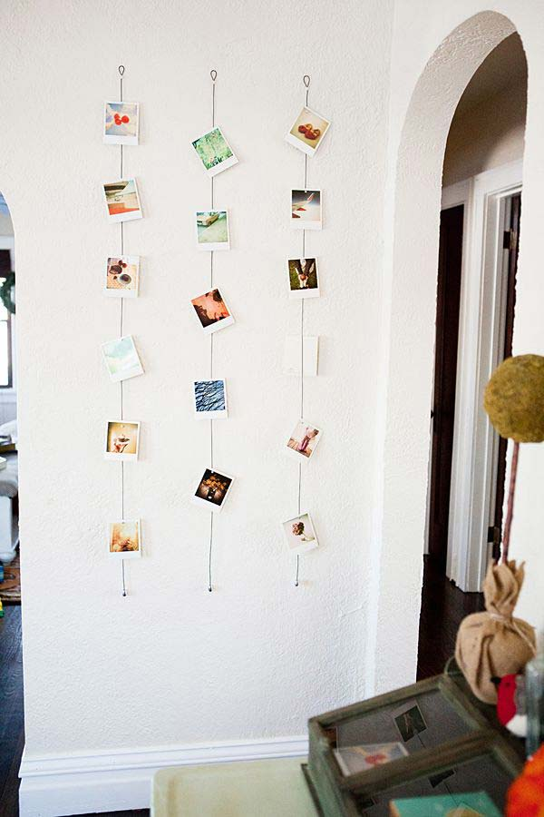 photos hanging on wires