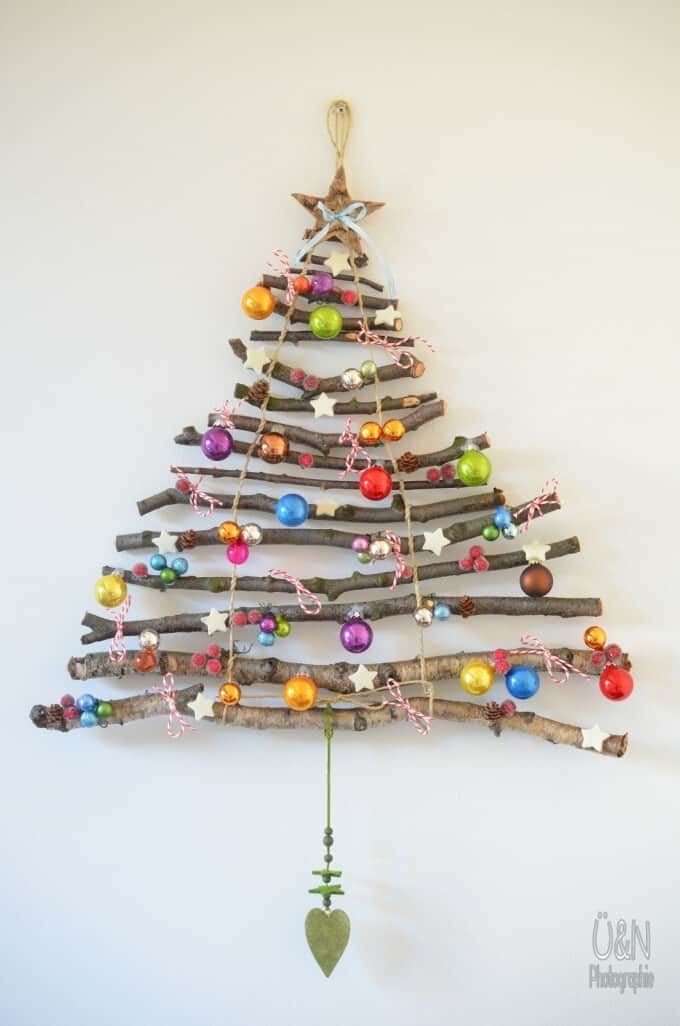 decorate your living room with this hanging christmas tree made from sticks